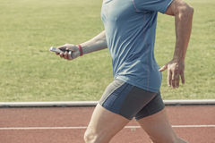 Runner checking fitness data Royalty Free Stock Photos