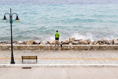 Runner on city street looking at inspiring sea view Royalty Free Stock Image