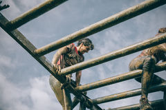 Runner climbing structure in a test of extreme obstacle race Royalty Free Stock Photos
