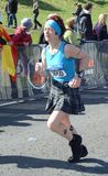 A runner competes in the Edinburgh Rock 'n' Roll Half Marathon 2012 Royalty Free Stock Photos