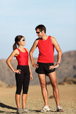 Runner couple. In nature taking a break after running in desert mountain landscape royalty free stock images