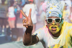 Runner Covered In Colors Flashes Peace Sign At Color Run Royalty Free Stock Images