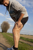 Runner with cramp Royalty Free Stock Image