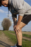 Runner with cramp Stock Image
