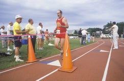 Runner crosses the finishing line Stock Images