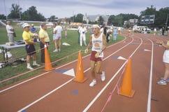 Runner crosses the finishing line Royalty Free Stock Images