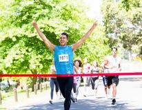 Runner crossing the finshline stock image