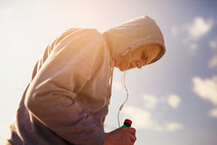 Runner Deep In Thought While Listening To Music. Stock Photo