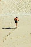 Runner in desert Royalty Free Stock Image