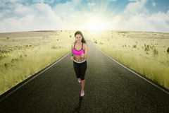 Runner doing exercise on the road Royalty Free Stock Image