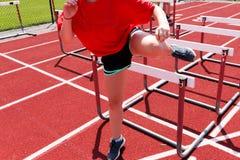 Runner doing hurdle drills Stock Images