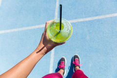 Free Runner Drinking A Green Smoothie On Running Track Stock Photos - 68707123