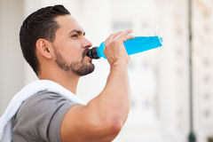Runner drinking a sports drink Stock Photo