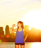 Runner drinking water city running in Montreal Stock Photo