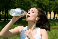 Runner drinking water outdoors Royalty Free Stock Images