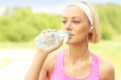 Runner drinking water in the park Stock Image