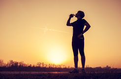 Runner drinks water after training Stock Photography