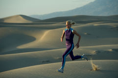 Runner on Dunes Stock Image
