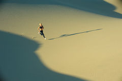 Runner on Dunes Royalty Free Stock Image