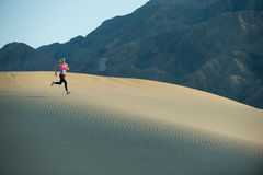 Runner on dunes Stock Photography