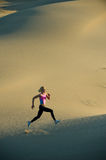 Runner on dunes. In a valley Royalty Free Stock Photos