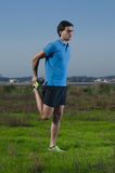 Runner exercising. Male runner exercising outdoors on country landscape Royalty Free Stock Photo