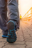 Runner feet jogging on road focus on shoe Stock Images