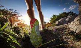 Runner feet running on path Stock Photo