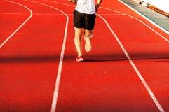 Runner feet running on racetrack Stock Photo
