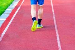 Runner feet running on racetrack Stock Image