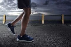 Runner feet running on the road royalty free stock photography