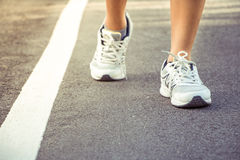 Runner feet running on road closeup on shoe. Stock Image
