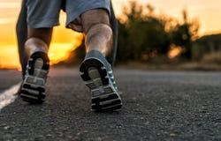 Runner feet running on road closeup Stock Photography