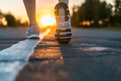 Runner feet running on road closeup Royalty Free Stock Image