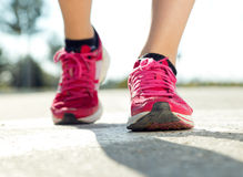 Runner feet running on road closeup on shoe. Royalty Free Stock Image