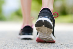 Runner feet running on road closeup on shoe Stock Image