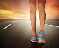 Runner feet running on road Royalty Free Stock Photo
