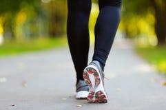 Runner feet running on road closeup on shoe Stock Image