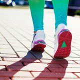 Runner Feet Running on road Closeup in shoe Stock Photography