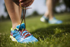 Runner feet running on road closeup on shoe Stock Photos