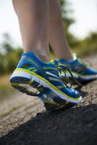 Runner feet running on road closeup on shoe Royalty Free Stock Photography