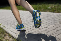 Runner feet running on road closeup on shoe Royalty Free Stock Photos