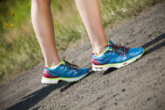 Runner feet running on road closeup on shoe Stock Images