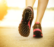 Runner feet running on road closeup on shoes Royalty Free Stock Images