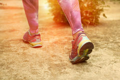 Runner feet running on road closeup on shoes. Royalty Free Stock Image