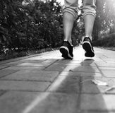 Runner feet running on road closeup on shoes Royalty Free Stock Image
