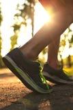 Runner feet running on road. Stock Photography