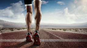 Runner feet running on road. Sports background. Runner feet running on road closeup on shoe Stock Photo