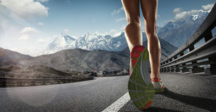 Runner feet running on road Royalty Free Stock Image