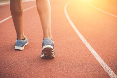 Runner feet on running stadium. Close up runner feet on running stadium Stock Images